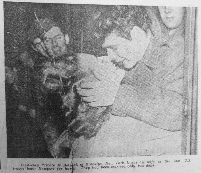 First Class Private Al Beigiel, of Brooklyn, New York, kisses his wife as last U.S. troops leave Newport for home. They have been married only two days.