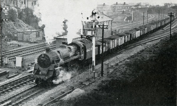 "Freight train, hauled by B.R. standard class ""4"" 4-6-0 No. 75008, passing Gaer Junction, west of Newport High Street Station"